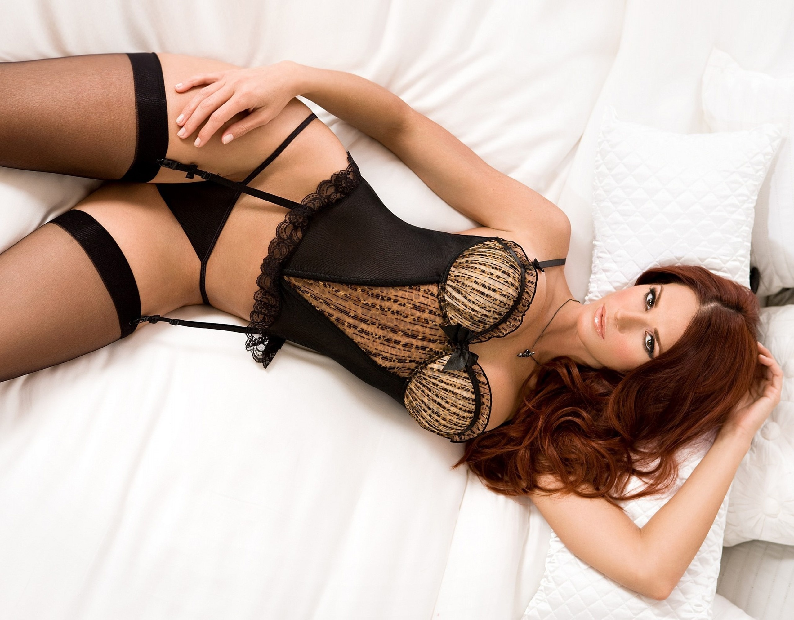 Aged brunette Mindi Mink removes see thru lingerie to pose on bed in stockings  680385