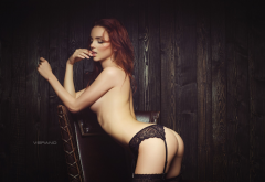 brunette, ass, topless, arched back, finger on lips, lingerie, garter belt, black stockings wallpaper