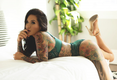 in bed, tattoo, green lingerie, high heels, ass, pierced nose, fetish wallpaper