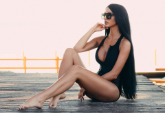sitting, tanned, black hair, long hair, sunglasses, one-piece swimsuit, sexy legs wallpaper