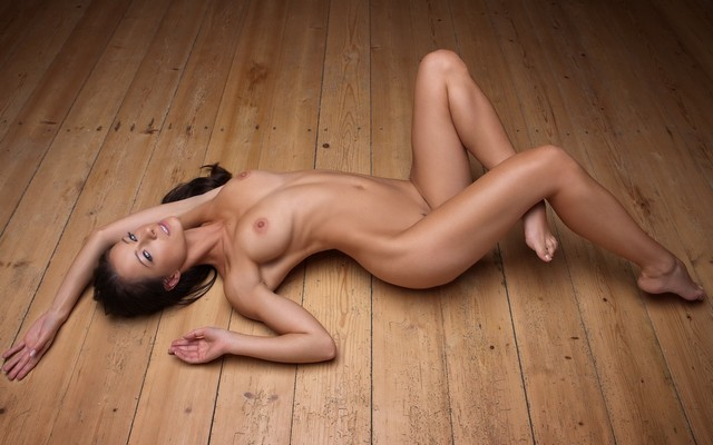 Nude girl lying down
