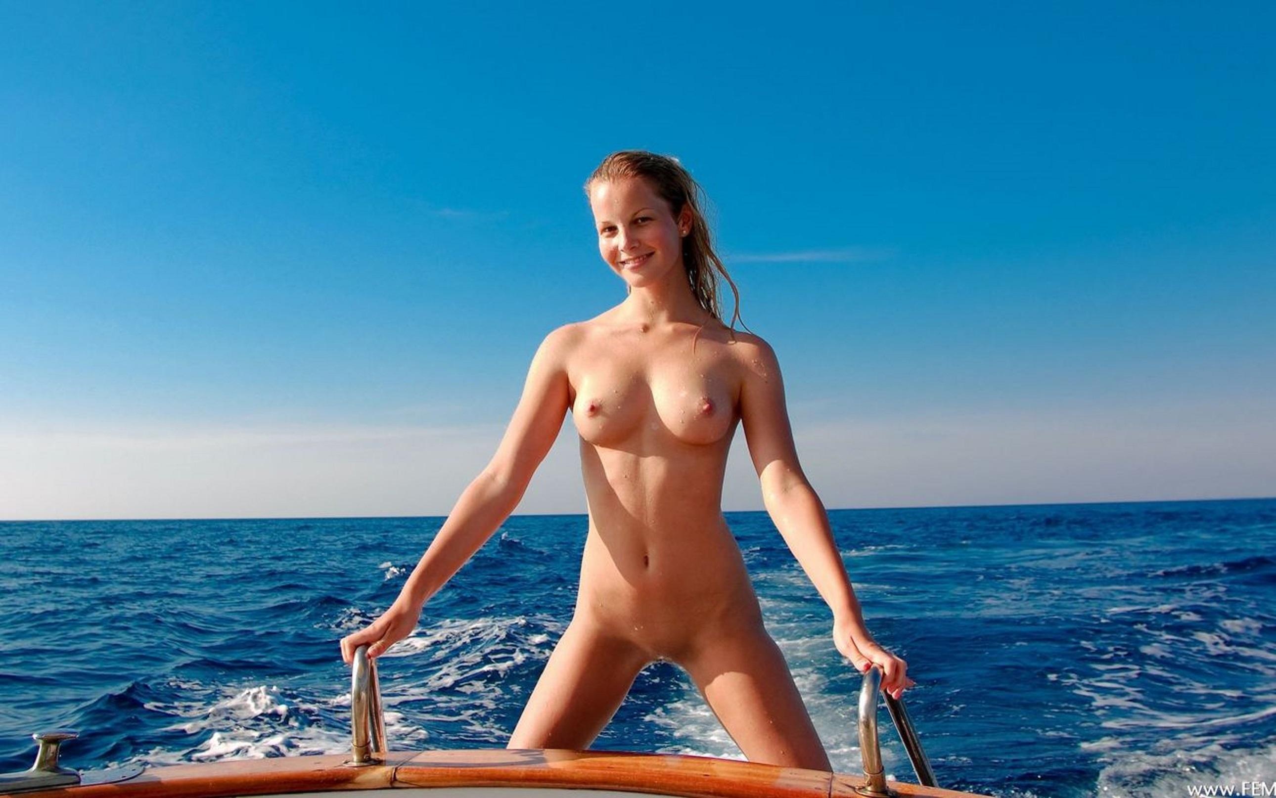 Nude girl straw hat kneeling boat — 6