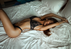 tanned, in bed, pillow, black lingerie, belly, smiling, pierced navel, black bra, black panties wallpaper